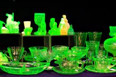 Uranium or vaseline glass. During the depression era people would make objects out of glass with small amounts of uranium in it. It fluoresces under blacklight.
