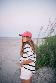 Coastal cruising in a nautical inspired pull over paired with white shorts and espadrille flats.