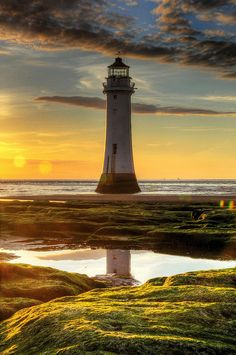 Mirrored image reflection, lighthouse symbolism, strength, direction, guidance, sun power