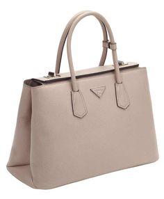 Prada Releases New Line of Bags in More Colors Than Skittles Read more: New Prada Bag - Twin Bag Prada - ELLE Follow us: @ElleMagazine on Twitter   ellemagazine on Facebook Visit us at ELLE.com