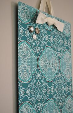 Flat cookie tray + fabric = instant, cheap, cute magnet board