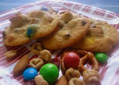trail mix cookies jam-packed with pretzels, m's, chocolate chips, almonds, peanuts, cereal, and craisins :)