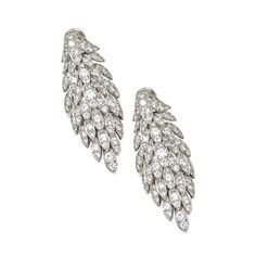 PAIR OF DIAMOND PENDANT-EARCLIPS, VAN CLEEF & ARPELS, 1968  Designed as flexible cascading leaflike clusters set with numerous round diamonds weighing approximately 10.60 carats, mounted in platinum, unsigned.