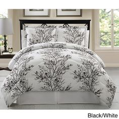 Sleep in elegance with this wonderful eight-piece bedding set. With matching sheets and pillow cases, this bedding set features a reversible surface adorned in a stenciled pattern of leaves, which softens the bold tones of the shams and comforter.
