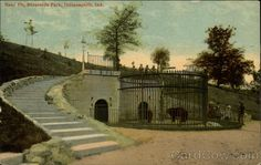 The Indianapolis Zoo originally  located at Riverside Park, closing in 1916, due to municipal restructuring. Shown is the bear cage at 30th St. bridge. http://www.cardcow.com/images/set335/card00287_fr.jpg