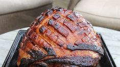 Glazed with a spicy-sweet mixture of Sriracha and orange marmalade, this baked ham is a knockout holiday roast
