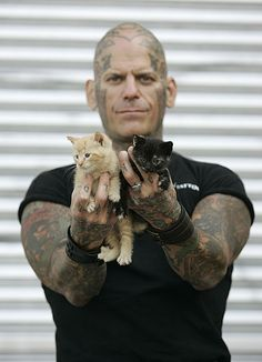 Rescue Ink: a bunch of bikers who got together to form a charity which rescues abused animals -- How can you NOT love this picture?
