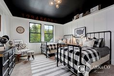 """Clark & Co Homes - 2016 Spring Parade Home """"The Heartland"""". Modern Farmhouse. www.clarkandcohomes.com. Built-in cabinetry; White Dove by Benjamin Moore; Black Magic. Boys bedroom. Black ceiling. Wainscot board and batten white. Industrial twin bed frames."""