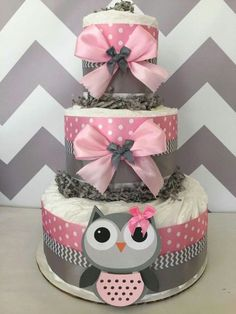 Pink and grey theme diaper cake with owl