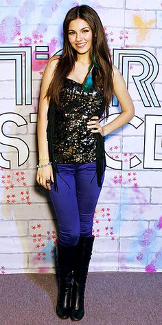 Even Celebs make mistakes - #VictoriaJustice made an usual fashion faux-pas pairing a sequin gold top with unflattering purple pants.The fringe vest just made it worse.