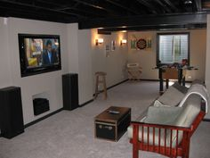 DIY Finished Basement. Notice how painting ceiling beams and ductwork makes them appear to recede.