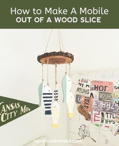 It's easy to make a cute and rustic diy mobile for baby boy with a wood slice and a few other items. This idea will definitely work for a girl's nursery or a gender neutral one as well.