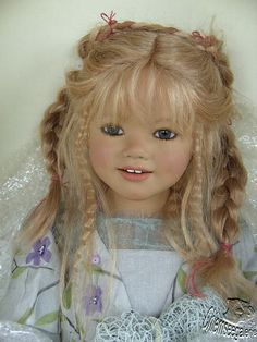 A repin of an Annette Himstedt doll named Merete, sandy blond hair with bangs and accent braids #doll #Himstedt