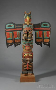 I like this totem because of it's interesting wing shape. This style is a little less common, it seems. Could help with design inspiration. More