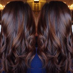 Brunette balayage chocolate red hair style done by @ashleymichelleartistry . Loose curls perfect for date night