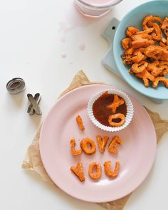 Use stainless steel alphabet cookie cutters - on sweet potatoes, cookies, fruits...  Try this for next valentine's day?? top a cookie with cut out letters (using something like fruit roll up)? to write a message!
