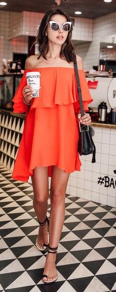 Way cute orange, off the shoulder dress! Paired with these super cute cat eyed sunglasses! We love!