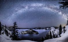 """https://www.facebook.com/BenCoffmanPhotography """"A starry night panorama of Crater Lake that I've been working on since I got back. It's nice to finally have it done. I managed to catch a few Lyrids (shooting stars) in the panorama. You can see 3 small ones in and around the left side of the Milky Way and one large one in the upper right side of the Milky Way. Additionally, you can see Andromeda next to the large tree on the left (it's the disc-like """"star"""")."""""""