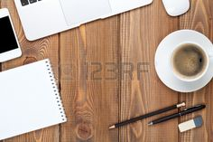 Office desk table with computer, supplies and coffee cup. Top view with copy space