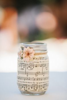 Maybe you need table decorations for a party or wedding on a budget? This DIY mason jar is a great idea - it uses sheet music and Mod Podge.