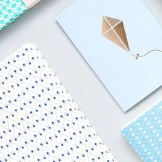 A Pastel Edit of the current collection | Dash print layflat notebook in klein blue | kite card in brass on blue #stationery #stationerylove #simple #illustration #pattern #madeinbritain by ola_studio