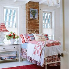 Layered bedding in mixed patterns adds a country cottage look.