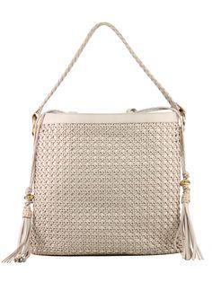 Exclusiva bolsa feminina em couro legítimo e confeccionada em tresse manual.