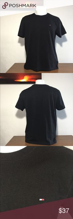 """Men's - Tommy Hilfiger Black Mini Logo T-Shirt This shirt is in excellent condition!! An embroidered logo is in the front left side of the chest. There is very slight fading at some of the seams, but it's not noticeable.  Approximate measurements: Total length - 24 1/2"""" Armpit to armpit - 19 1/2"""" Sleeve length - 7 3/4""""  🚫Sorry, no trades or modeling🚫  M1068 Tommy Hilfiger Shirts Tees - Short Sleeve"""