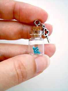 Tiny dragon in a bottle - OOAK pendant in turquoise blue and silver with key charm