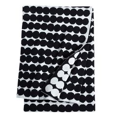 Marimekko Rasymatto Knit Blanket The bold dots of Maija Louekari's Rasymatto pattern are softened by the warmness of a wool blend for a lightweight blanket that's comfortable year-round. The Marimekko Raysmatto Knit Blanket will be a .