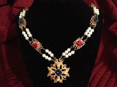 Renaissance necklace by Karen Troeh with red and blue rhinestones on gold filigree links, glass pearls, and a vintage Maltese cross jeweled pendant. This one is sold, but visit my Etsy shop for similar items or to request a custom design.