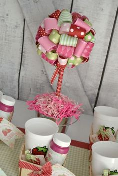 Ribbon centerpiece at a Strawberry girl Birthday Party!  See more party ideas at CatchMyParty.com!