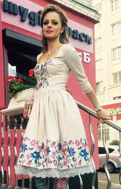 Embroidered cotton dress. Flowers pattern.