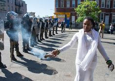 Shameeka Dream conducts a spiritual healing in front of a police line.