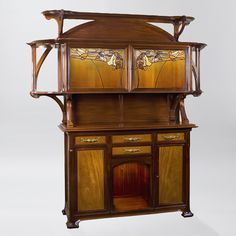 A French Art Nouveau mahogany and walnut buffet by Paul Bec, featuring two leaded glass doors depicting leaves and flowers. Similar buffet pictured in: The Paris Salons 1895 - 1914: Volume III: Furniture, by Alastair Duncan, page 48.  The furniture mounts are  pictured on page 148 of The Paris Salons 1895-1914:  Volume V:  Objets d'Art & Metalware.
