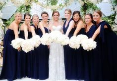 Long navy bridesmaid gowns. Bouquets by The Garden Gate. Wedding by DFW Events. Photo by Andrea Polito Photography. #wedding #bridesmaids #navy