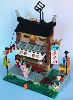 Ramen and sushi bar is mouth watering — The Brothers Brick - Lego Hacks Photos ! Lego Minifigure Display, Lego Display, Lego Ninjago City, Lego City, Lego Craft, Lego Modular, Lego Architecture, Classic Architecture, Cool Lego Creations
