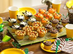 Jungle Animal Cupcakes  Create a jungle of decorating activities by making kids' favorite animals.