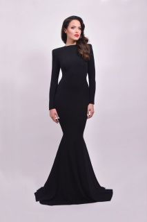 Black jersey mermaid gown with strong shoulders and open back. - Michael Costello US Size Chart - Made true to size - When choosing height, include the inches of your heels - If you select custom, one of our representatives will contact you for size information - Dry clean only