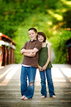 Cute pose for brother and sister. [My brother and I once did this.] Lovely!