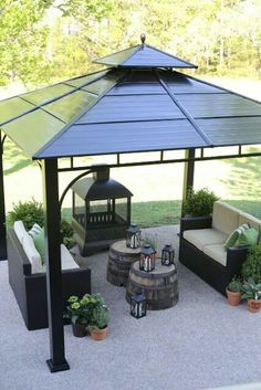 Anchor Your Outdoor Space With A Gazebo That Provides Shelter For A  Comfortable Seating Area And Cozy Fireplace. Groupings Of Plants And  Lanterns Soften ...