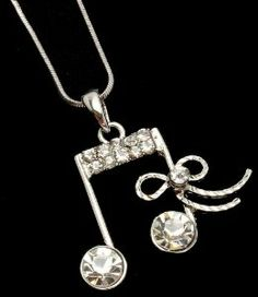 """Pretty Austrian Crystal Embellished Silver Large Musical/Music Note with Ribbon Bow Accent Necklace Necklaces by Glamour Girl Gifts. $17.99. Chain is 17"""" with a 3"""" extender. Lead and nickle safe - Comes gift boxed. Large musical note charm measures 1"""" long x 1-1/2"""" wide including bow. Silver rhodium plated"""