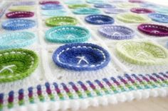 ButtonArtMuseum.com - Crochet Pattern Bright as a Button Blanket Baby by FeltedButton