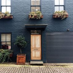 Image result for painted brick with natural window molding