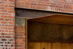 Another piece of Corten steel juts out over the entrance, a minimal gesture of wayfinding - 58 Kent Street - Scott Henson Architect