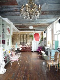 Mecho! I love the combination of the old corrugated tin ceiling and the crystal chandelier!