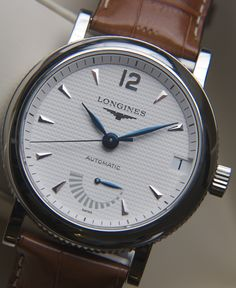 longines - date window + power reserve indicator of remaining reserve it has before you need to wind it or shake your wrist for the automatic movement to wind it / but winding rapidly winds it ✅