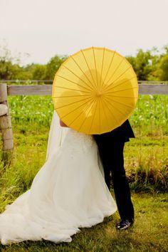 Love a parasol at a wedding!