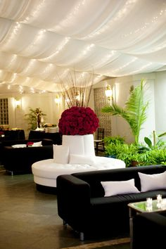 String lights in fabric draped ceiling- red, black and white wedding lounge decor