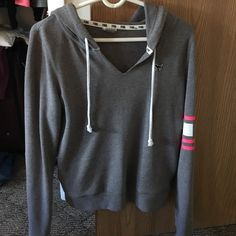 VS Pink Hoodie Light grey VS Pink hoodie with hot pink and white detail on one sleeve Victoria's Secret Sweaters